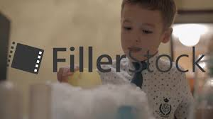 boy watching reaction of mixing dry ice and liquid nitrogen fun