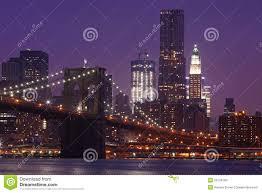 brooklyn bridge and manhattan skyline at night nyc stock photo