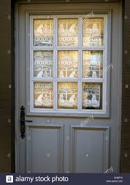 front door with cat lace curtains stock photo royalty free image