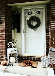 How To Make Halloween Door Decorations Eeeeek It U0027s A Pet Cemetery Halloween Front Door Discover