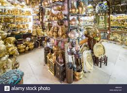 cairo egypt shop selling ornate gold pots and vases in the