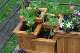tiered wood deck flower boxes on corner of deck flower box designs