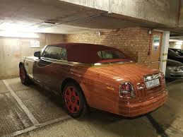 roll royce brown drop top rolls royce phantom body wrapped to look like chitty