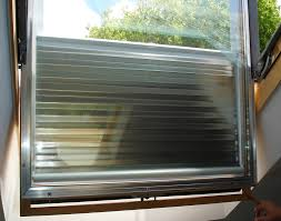 rolla ray u201d transparent solar film roller blinds manufactured by