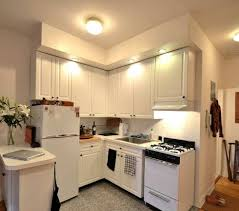 small open kitchen designs with white cabinets and fridge and free