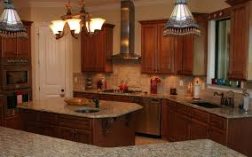 kitchen stone backsplash kitchen stone floor sink faucet black granite countertop wooden