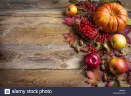 thanksgiving greeting background with orange pumpkins apples and