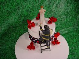 fireman cake topper blowing kisses and fireman to the rescue groom firefighter