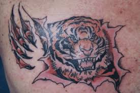 tiger ripping through skin ripped skin angry tiger design by