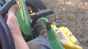 mowing with the john deere 325 youtube