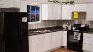 considering the dark and cool black kitchen cabinets image on