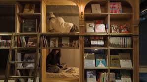 in tokyo u0027s library hotel guests sleep in the bookshelves u2014 quartz