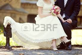 and white wedding two golden wedding rings and feather stock photo picture and
