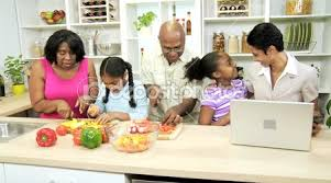 Cooks In The Kitchen by Family Cook In The Kitchen When A Businesswoman Talking On Mobile
