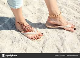 female legs with henna tattoo u2014 stock photo belchonock 130779942
