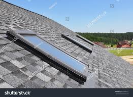 attic skylight asphalt shingles house roofing stock photo