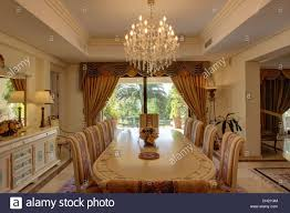 Chandelier Above Table With Upholstered Chairs In Newbuild - Dining room spanish
