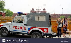 jeep india police jeep in front of red fort india as a foreign tourist takes