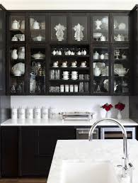 kitchen inspiring black kitchen cabinets glossy refrigerator with kitchen captivating black kitchen cabinets with glass doors and white marble counters filled with household