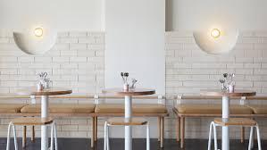 white brick and reclaimed eucalyptus wood fill sydney dessert kitchen