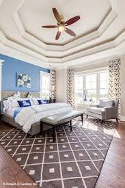 this master bedroom features a vaulted ceiling and arched window