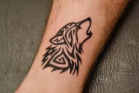 tribal wolf on the arm maybe