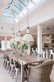 top 25 best dining tables ideas on pinterest dining room table rattan chairs dining chairs and low modern industrial style lighting love how the skylight