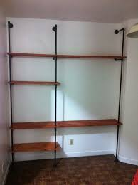how to build a plumbing pipe shelving wall unit easy diy diy