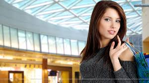 female standing pose in shopping mall wallpaper