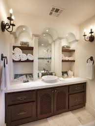 lighting bathroom vanity with towel storage and vessel sink also