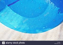 swimming pool background with concrete and blue tiles in a curve