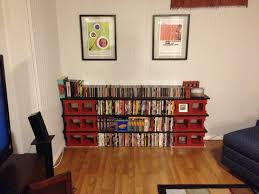 exterior cinder block bookcase with un polish wooden placed on