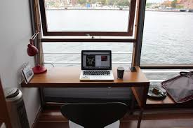 minimal desks window set desk with views over the water