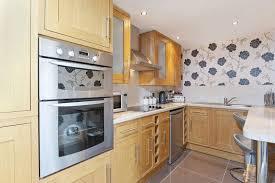 modern kitchen wallpaper ideas white kitchen floral feature wall wooden cabinets lentine marine
