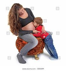 pregnant mother sitting on a leopard stool her son embracing her