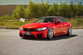 stanced bmw m4 bmw m4 glows in orange and pur wheels