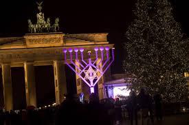 hanukkah candelabra at brandenburg gate photos and images getty images