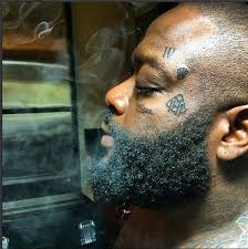 rick ross gets miami heat face tattoo inked magazine