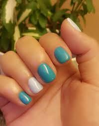 blue nails manicure in cnd shellac cerulean sea dark and