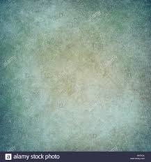 faded blue green background with painted wall or canvas texture