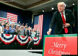 president donald j pointed to a sign that read merry
