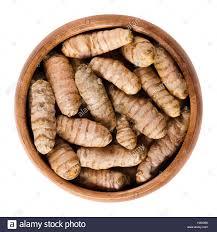 curcuma en cuisine fresh turmeric rhizomes in wooden bowl curcuma longa also