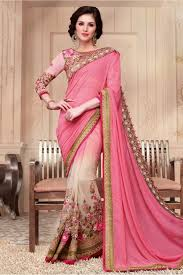 and net designer party wear saree in baby pink and cream colour