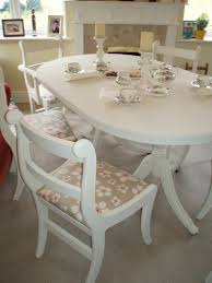 hand painted dining table and 6 chairs with vanessa arbuthnott