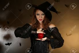 dark halloween background halloween witch with apple on dark background stock photo picture