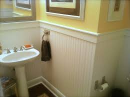 bathroom with beadboard and board and batten wainscot wainscoting