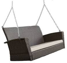 unbranded modern dark brown resin wicker porch swing with khaki