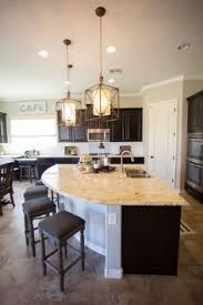 From The Rounded End Of The Island Great Seating Area - Kitchen island with cabinets and seating