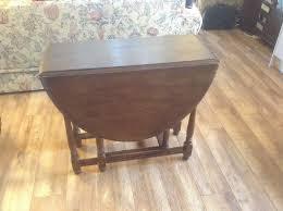 dark wood drop leaf table drop leaf oval dining table in dark wood oak in longfield kent