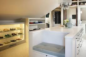 attic walk in closet with built in shoe shelves transitional